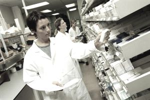 Female pharmacists looking through medical stores