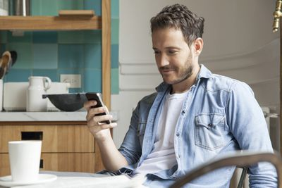 Man looking for work on phone