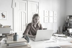 Young businesswoman working on laptop in home office
