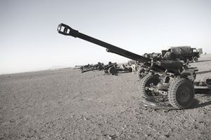 Howitzer 105mm light guns are lined up at Camp Bastion, Afghanistan, ready for test firing.