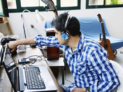 A Composer Connecting a Laptop to a Music Keyboard