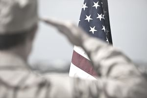 Soldier saluting the American flag