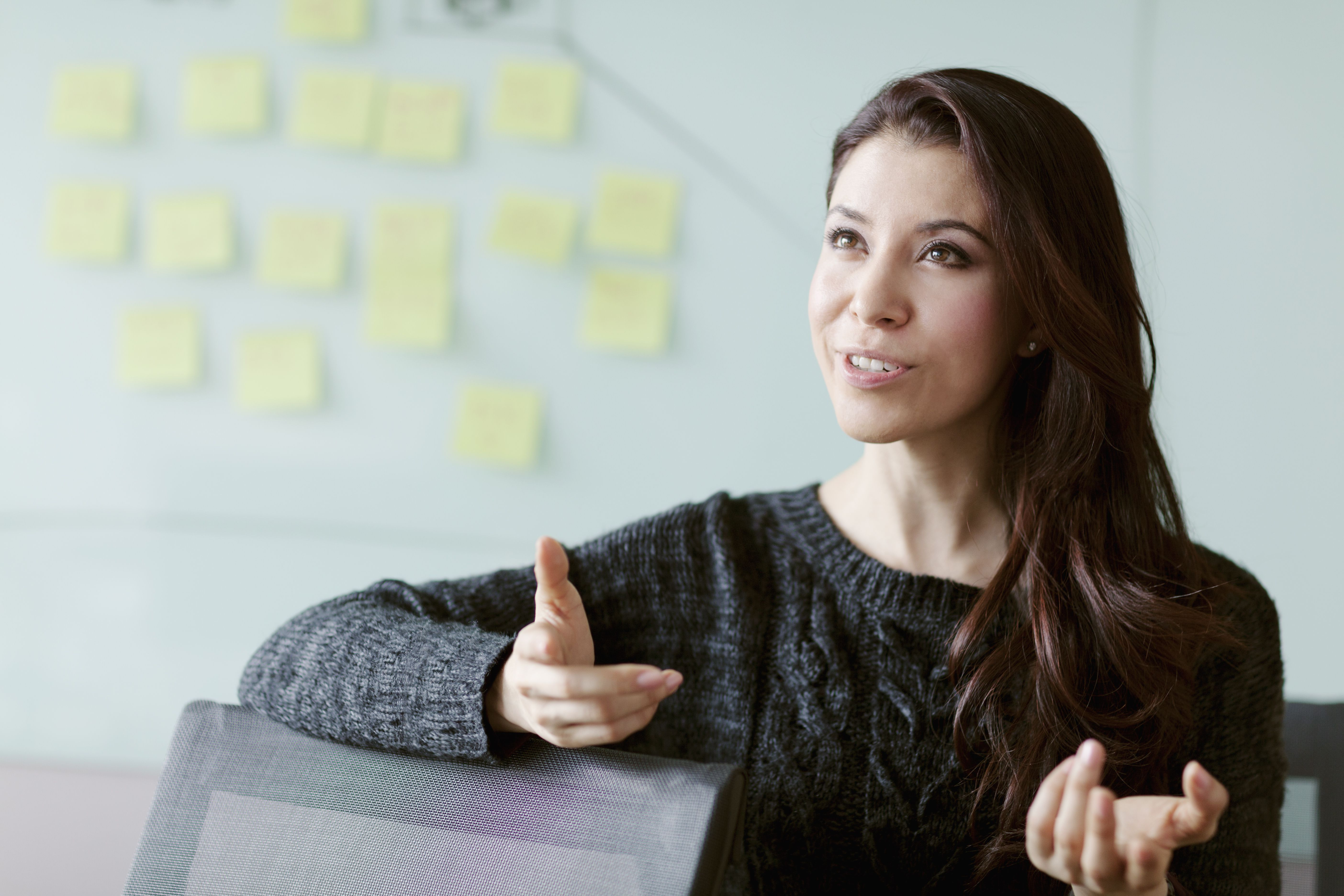 Woman discussing ideas and strategy in studio office