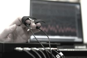 A computerized polygraph machine on fingers
