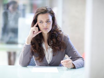 A woman sits at work desk and wonders whether she can make her current job work - or if it's time to quit.
