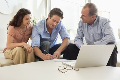 Couple signing papers with financial advisor