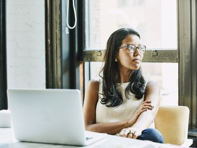 Woman thinking at office desk
