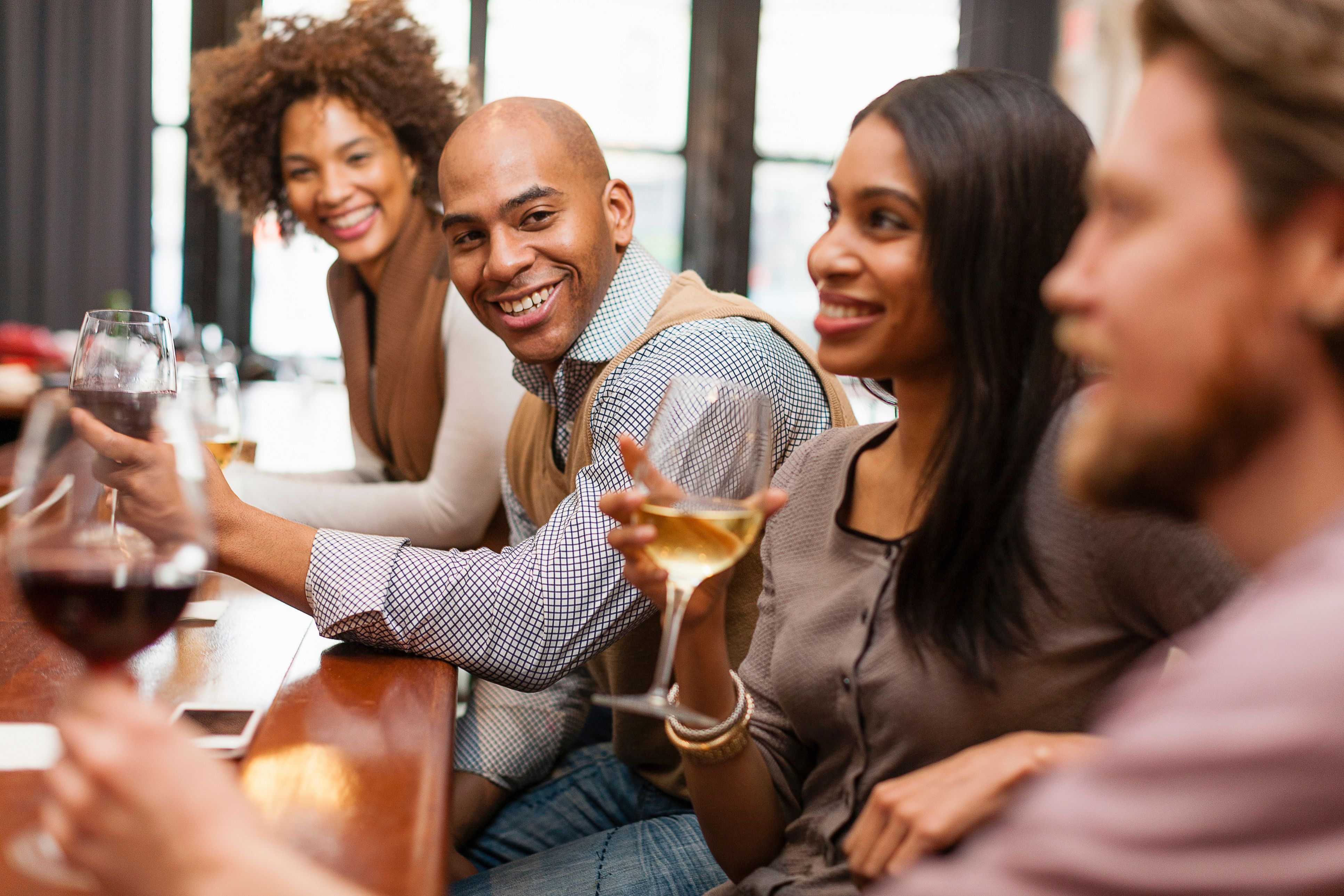 Group of workers enjoying a fun culture of happy hour together after work.