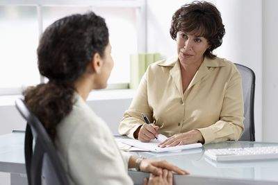 Hiring manager using checklist for applicant interview