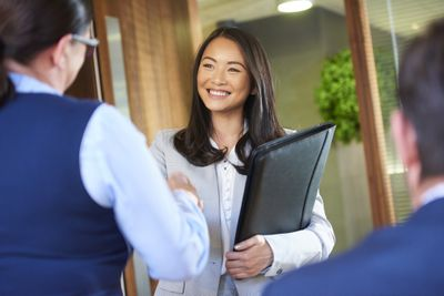 job candidate smiling as she enters the interview