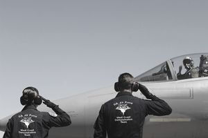 U.S. Air Force Airmen Salute the Captain of an F-15 Eagle