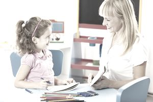 Speech pathologist at work with with a child.