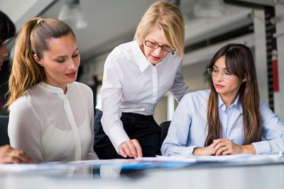Businesswoman gesturing in conference room meeting