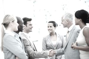 Diverse group shaking hands and networking