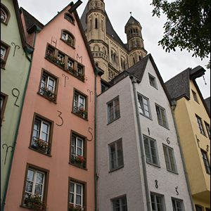 Row of tall, thin historical homes in Cologne Germany