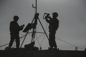 U.S. Air Force members conduct an inspection of a weather sensor.