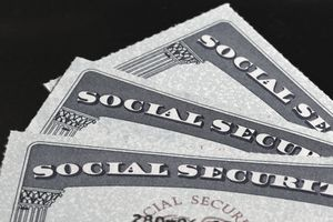 close up of three social security cards fanned out