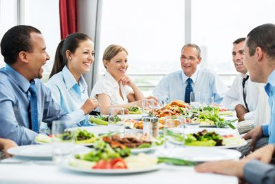 Employees enjoying a catered lunch at work