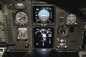 Cockpit display showing the map display that depicts terrain ahead, airspeed, attitude indicator and altimeter.