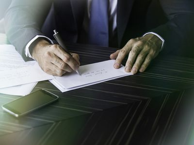 Man Writing Letter of reference for a laid off technical writer.