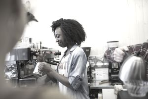 Teenager working in a coffee shop in North Carolina under the state's child labor laws.