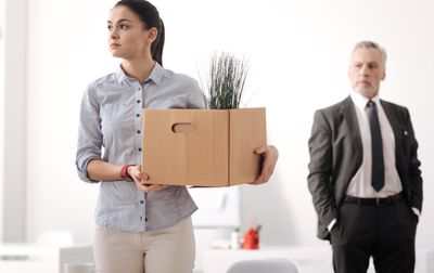 Confident woman taking her things in box
