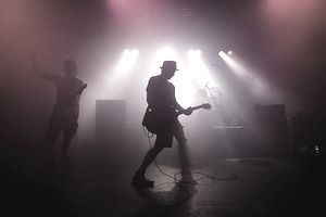 a silhouette of musicians at a rock concert
