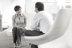 Man and woman sitting and talking in job interview
