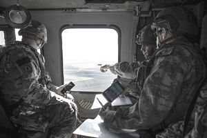 U.S. Army soldiers in a Black Hawk helicopter.