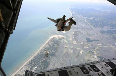 U.S. Marines exit the ramp of a C-130 aircraft