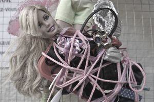 Barbie doll wrapped in string