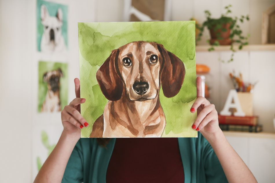 Artist hiding behind portrait of a dachshund