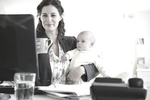 USA, New Jersey, Jersey City, Mother with baby boy (2-5 months) working from home