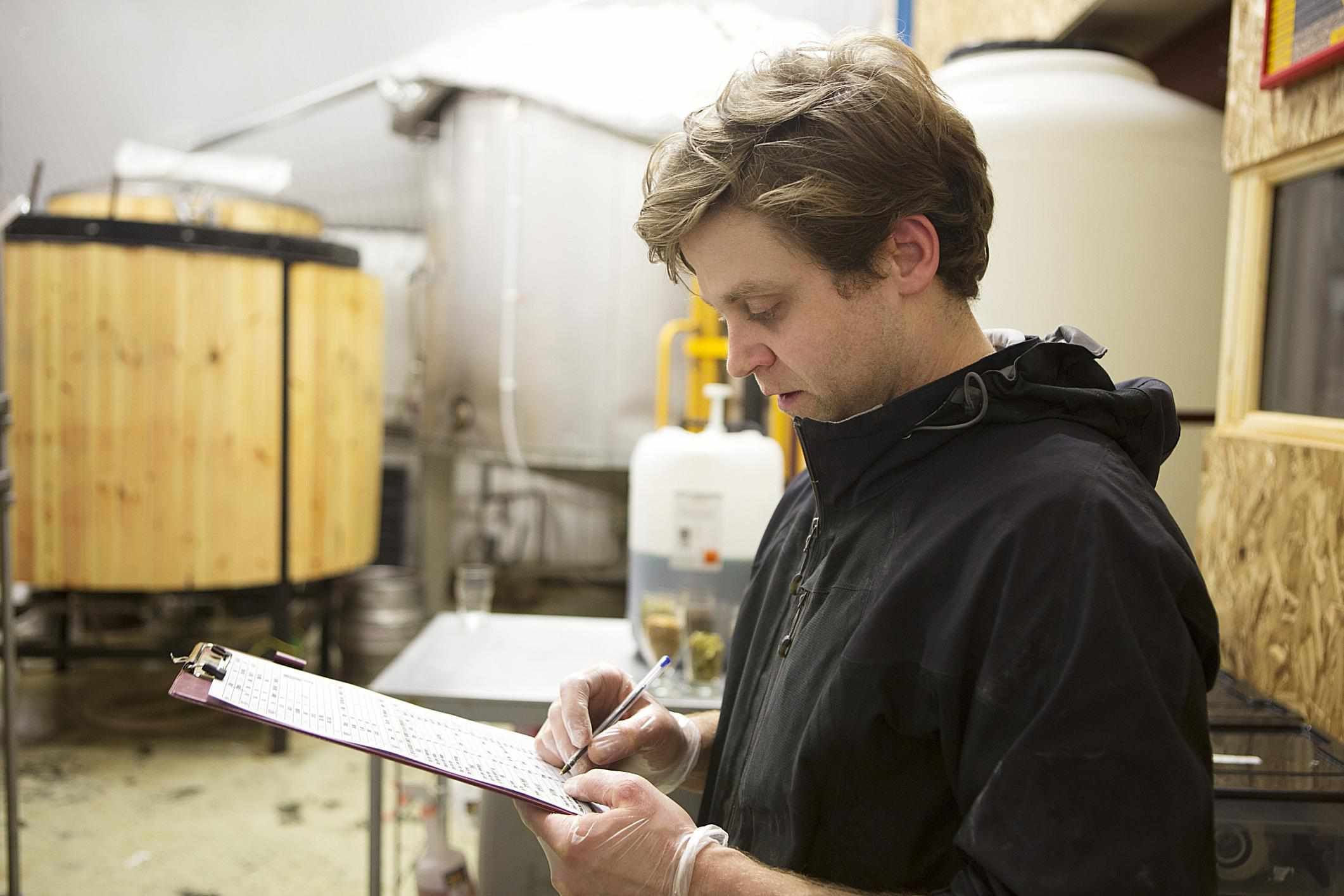 Brewer looking at clipboard