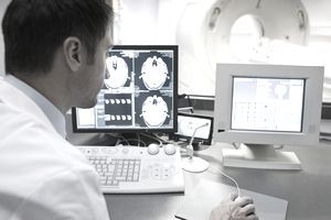 doctor analyzing a CT scan of a patient