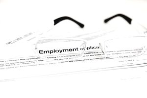 eyeglasses sitting on top of employment application