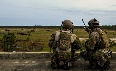 Two TACP surveying a battlefield.