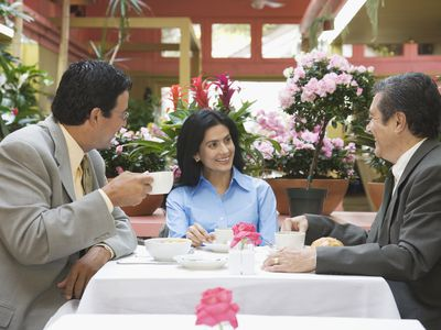 Businesspeople talking at restaurant