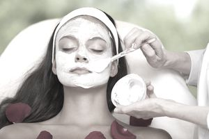 An esthetician applies a facial