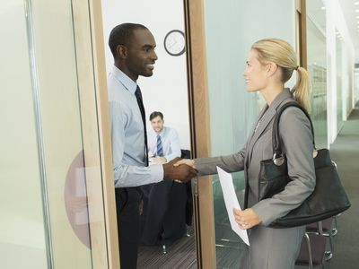 Business people shaking hands in office before an interview