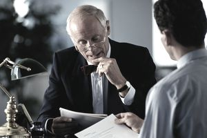 Man meeting with lawyer/legal advisor
