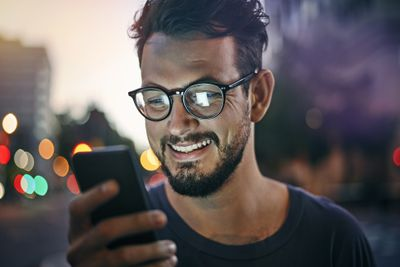 Young man looking at a smart phone