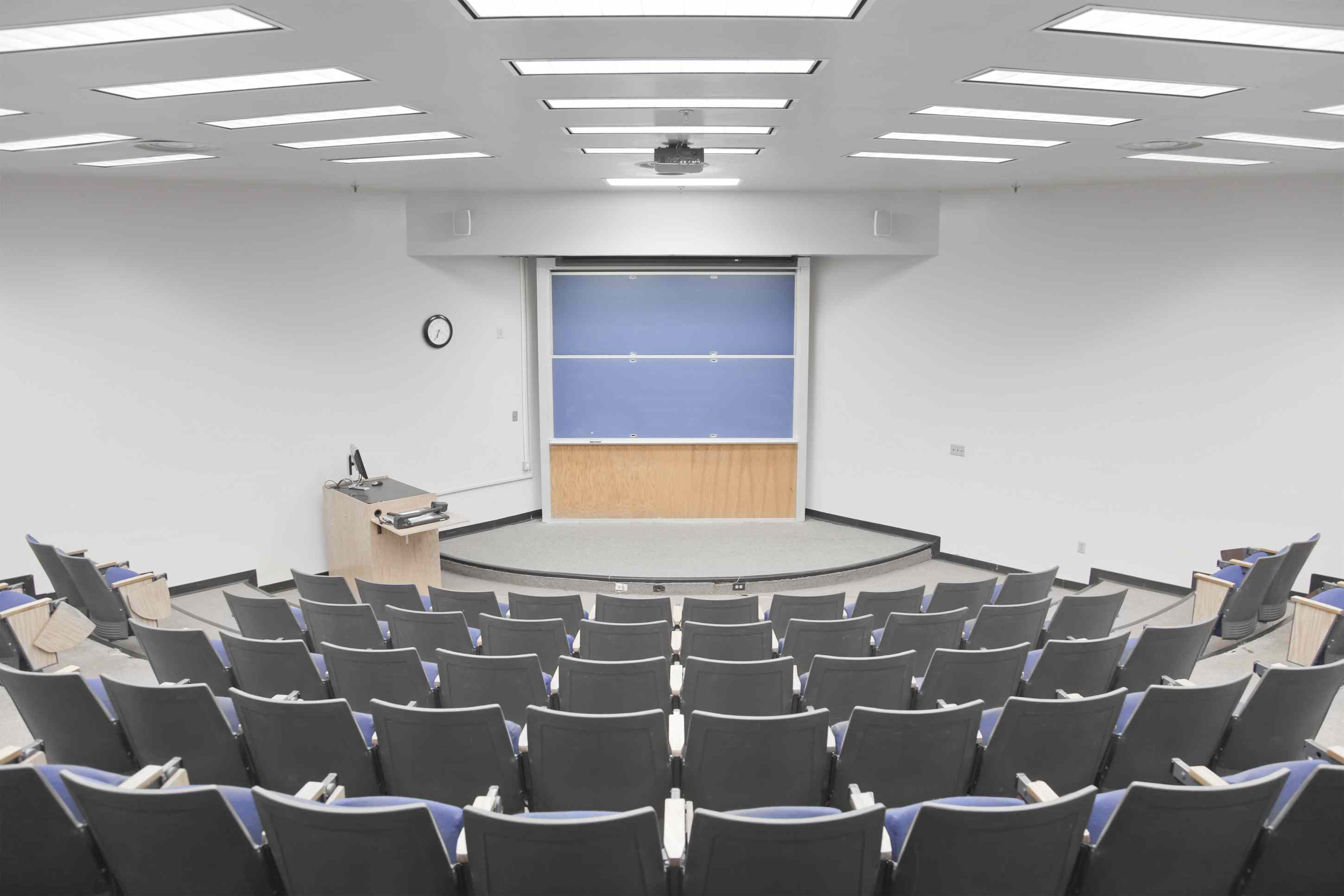 Empty university lecture hall with curved seating