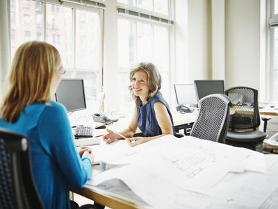 Woman conducting job interview with applicant in office.