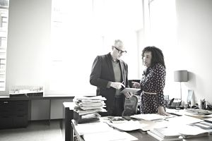 Young woman getting advice from mentor in office setting
