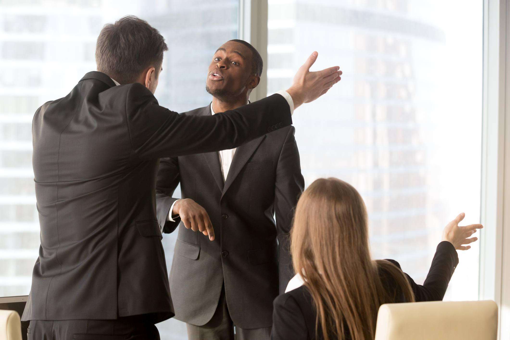 Business people gesturing during a heated argument.