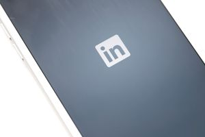 The LinkedIn Corp. app logo is displayed on an Apple Inc...