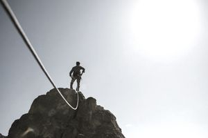 man accomplishing challenge on a mountain