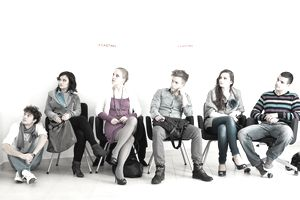 a group of young people sitting and waiting to audition at a casting call
