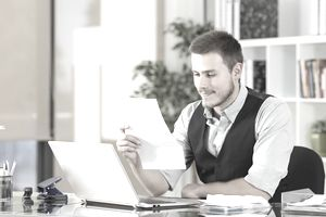 Businessman reading a letter at office